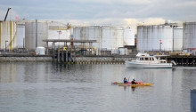Kayakers and motorboat on the Thea Foss Waterway