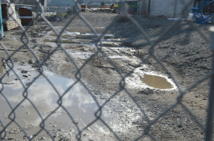 Standing water on ground at the edge of a new construction project on Thea Foss Waterway