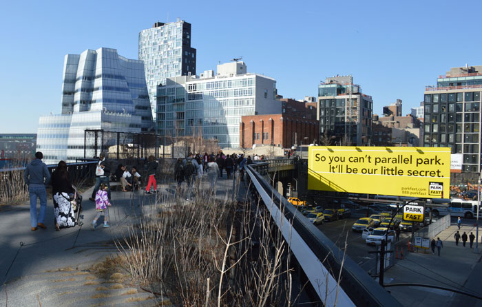 High Line walkway and nearby billboard