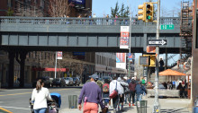 Pedestrians on the street level and on the raised High Line park walkway