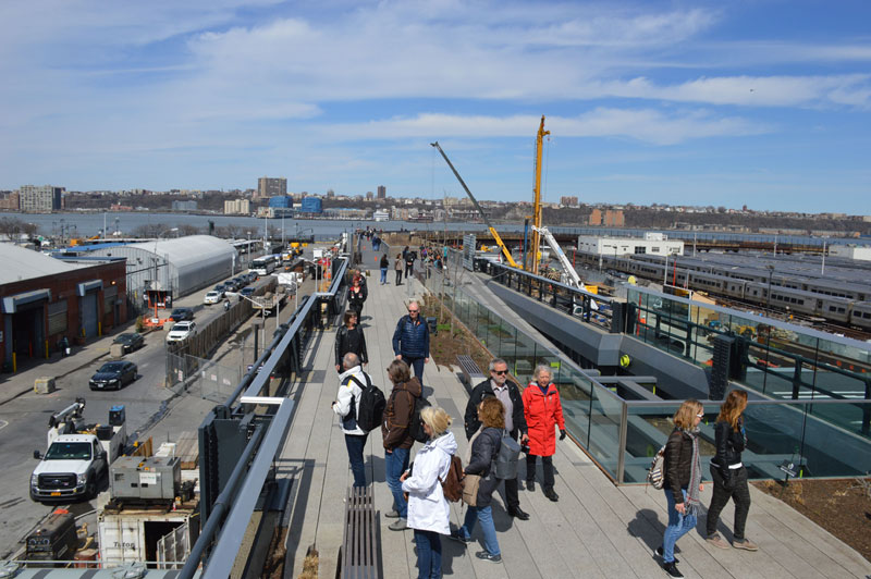 Visitors strolling on the High Line near the Rail Yards