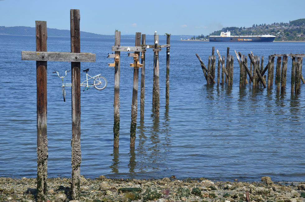 Pilings with Bicycle and Cargo Ship on Commencement Bay, Tacoma, WA